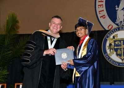 Cristo Rey Tampa Class of 2021 graduate receiving diploma