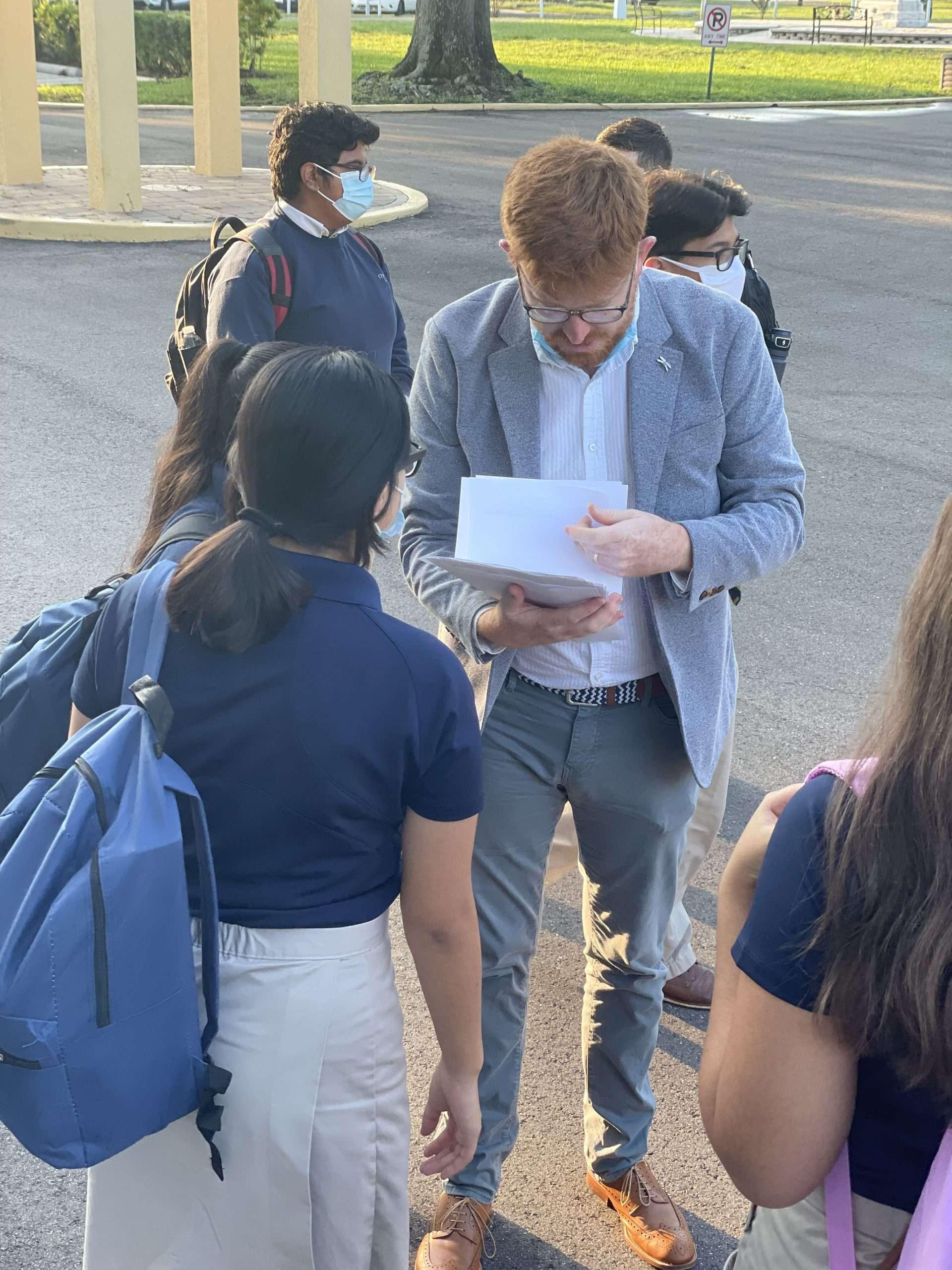 Mr. Lambert passing out class schedules